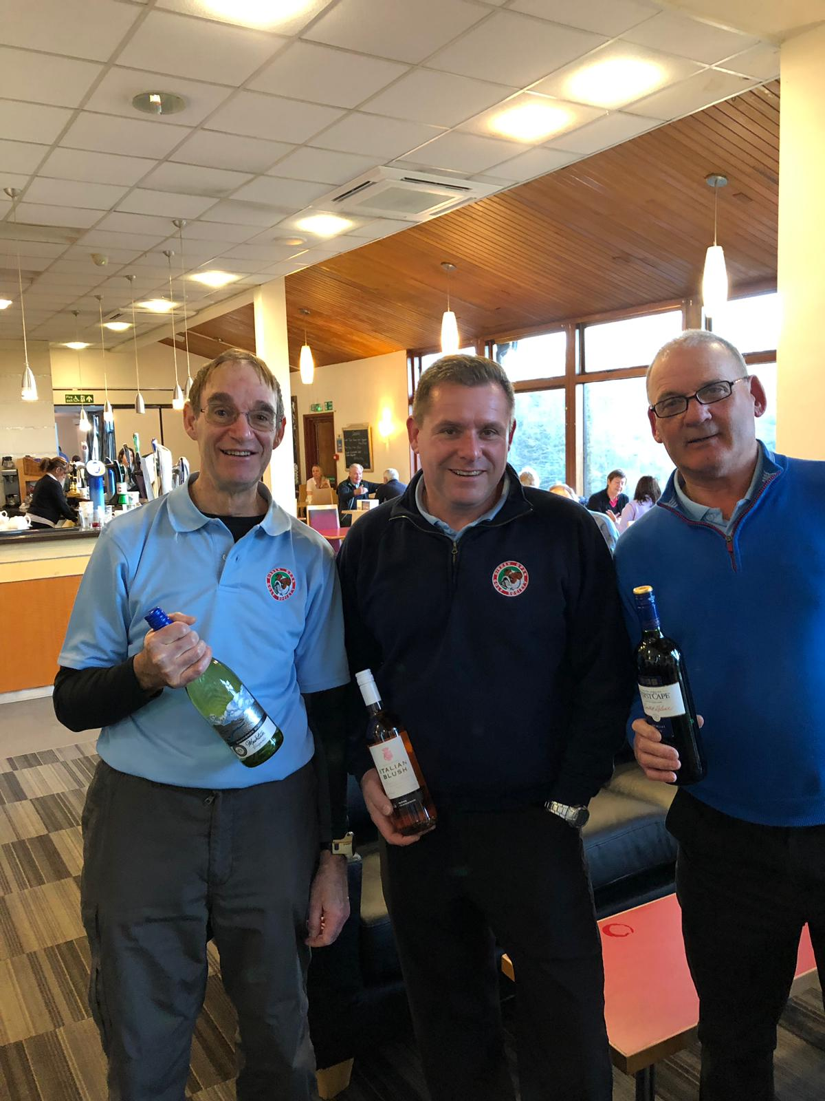 8 Jan. Wine winners L to R: R James; P Mortimer; K Maton